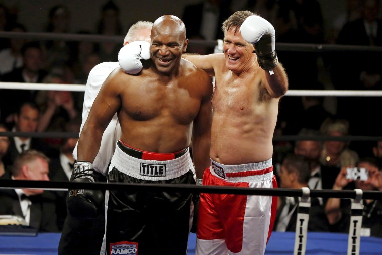 Former Massachusetts Governor Mitt Romney and five-time heavyweight champion Evander Holyfield celebrate after their boxing match in Salt Lake City, Ut. on May 15, 2015. (Photo by Jim Urquhart/Reuters)