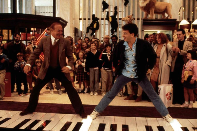 Robert Loggia, left, and Tom Hanks stand on a giant piano keyboard at the FAO Schwartz toy store in a still from the film 'Big' directed by Penny Marshall. (Photo by United Archives/ullstein bild/Getty)
