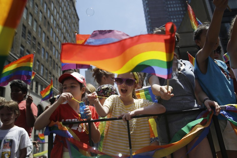 Children blow bubbles as they pass by on a float in the Gay Pride Parade in New York on June 29, 2014. (Photo by Seth Wenig/AP)