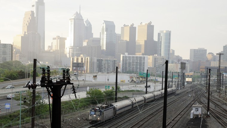 An Amtrak train travels northbound from 30th Street Station, May 18, 2015 in Philadelphia. (Photo by Matt Slocum/AP)