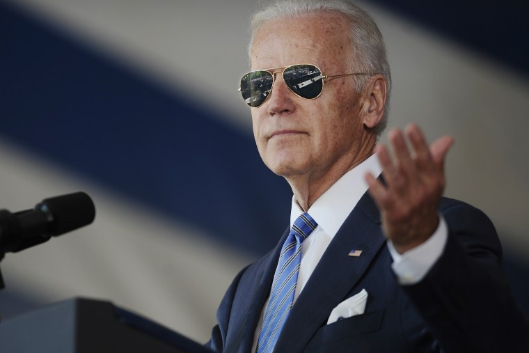 Vice President Joe Biden gestures after donning a pair of sunglasses as he delivers the Class Day Address at Yale University on May 17, 2015, in New Haven, Conn. (Photo by Jessica Hill/AP)