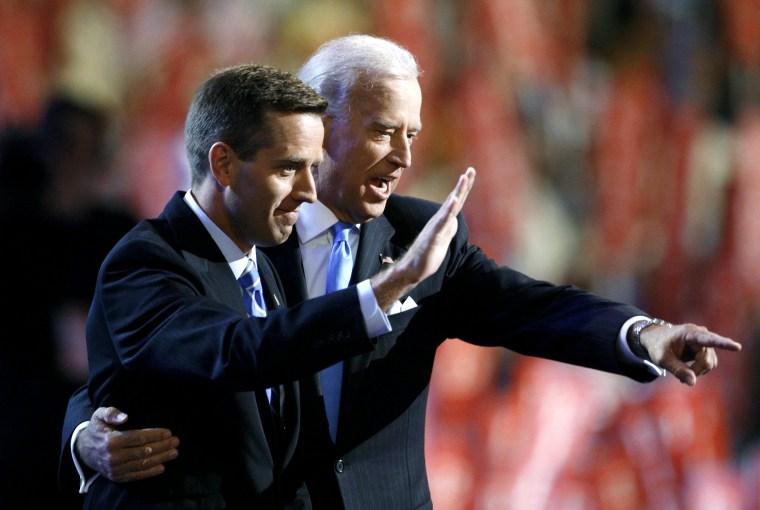 Then-Attorney General Beau Biden (D-DE) (L) and Vice Presidential candidate Senator Joe Biden (D-DE) gesture on stage at the 2008 Democratic National Convention in Denver, Colo., Aug. 27, 2008. (Photo by Chris Wattie/Reuters)