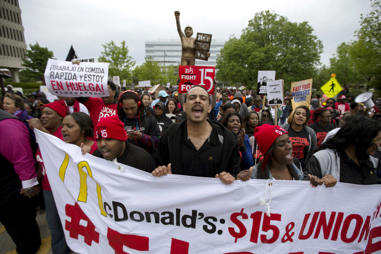 People protest outside of the McDonald's headquarters in Oak Brook, Ill., May 20, 2015. The demonstrators were calling for higher wages and better work conditions. (Photo by Andrew Nelle/Reuters)