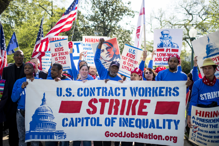 U.S. Senate contract employees along with hundreds of workers from the Capitol, Pentagon, Smithsonian Institution and others march to the Capitol to call on a living wage of at least $15 an hour, April 22, 2015. (Photo By Bill Clark/CQ Roll Call/Getty)