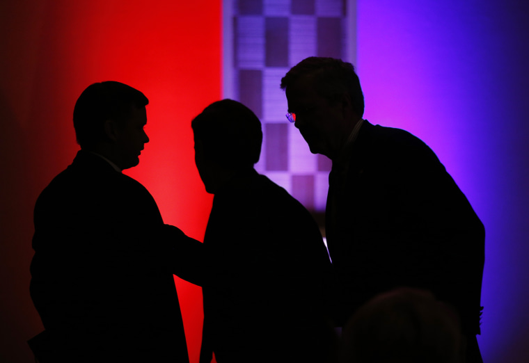 Former Florida Gov. Jeb Bush, right, attends a Clark County Republican Party dinner, May 13, 2015, in Las Vegas. (Photo by John Locher/AP)