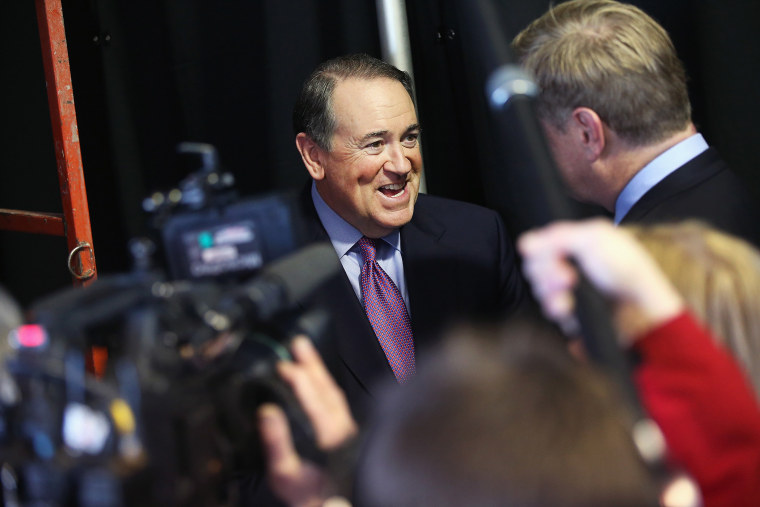 Former Governor Mike Huckabee of Arkansas fields questions from reporters at the Iowa Ag Summit on March 7, 2015 in Des Moines, Iowa. (Photo by Scott Olson/Getty)