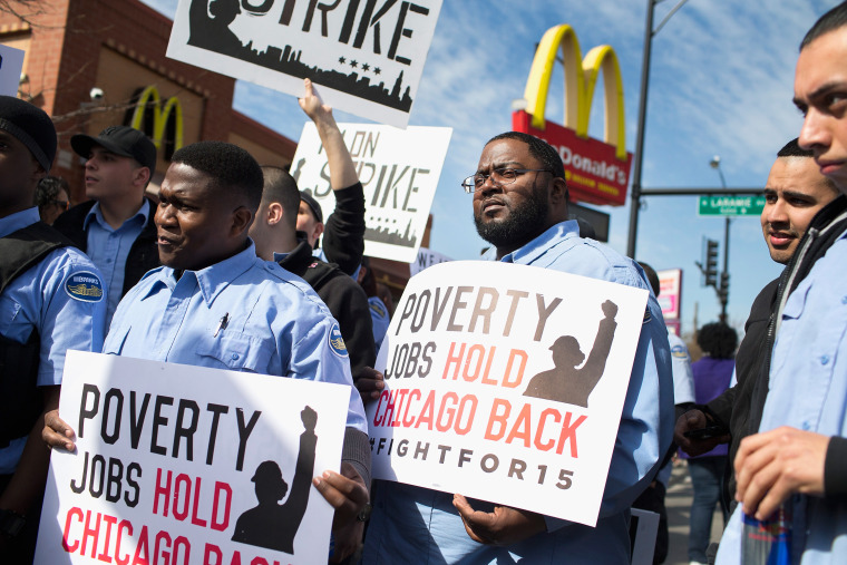 Demonstrators gather in front of a McDonald's restaurant to call for an increase in minimum wage on April 15, 2015 in Chicago, Ill. (Photo by Scott Olson/Getty)