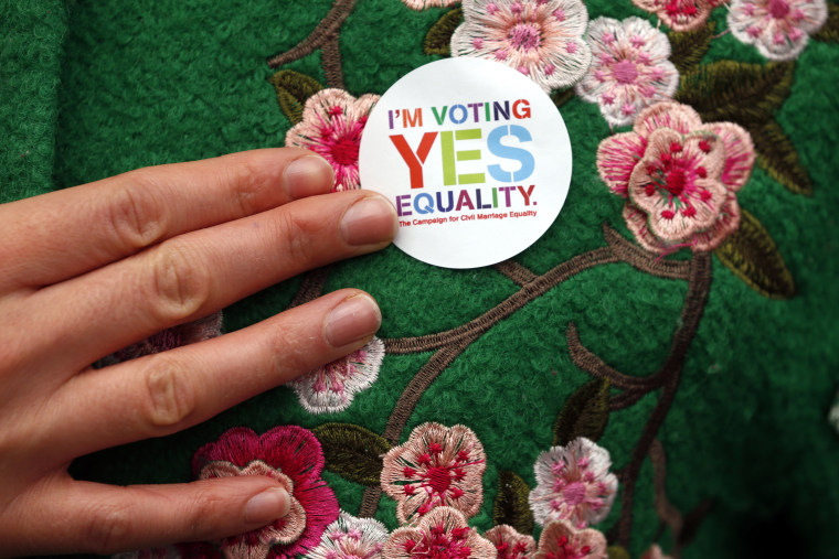 A Yes supporter shows her campaign badge in central Dublin, Ireland on May 21, 2015. (Photo by Cathal McNaughton/Reuters)