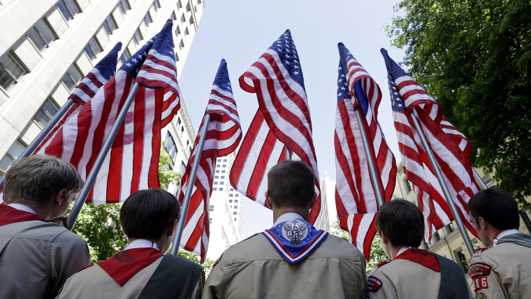 Boy Scouts from the Chief Seattle Council carry U.S. flags as they prepare to march in the Gay Pride Parade, June 30, 2013, in downtown Seattle. (Photo by Elaine Thompson/AP)