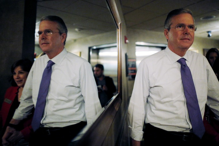 Potential 2016 Republican presidential candidate and former Florida Governor Jeb Bush is reflected in a mirror as he departs after speaking to the Greater Salem Chamber of Commerce in Salem, N.H. May 21, 2015. (Photo by Brian Snyder/Reuters)