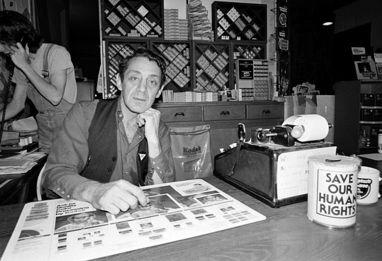 Harvey Milk, a gay political leader in San Francisco, is seen pictured in his camera store on Castro Street on June 28, 1977 in San Francisco. (Photo by STF/AP)