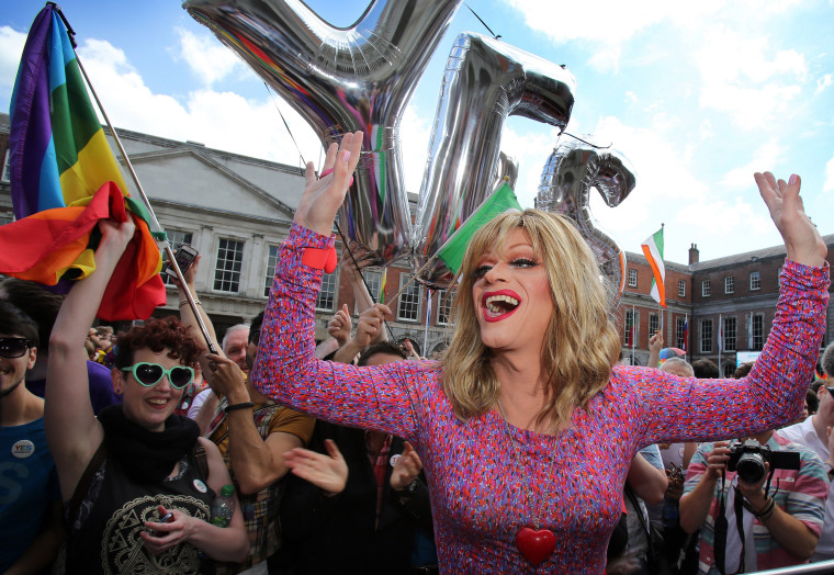 Drag queen and gay rights activist, Rory O'Neill, also known by his stage name Panti raises her arms by supporters for same-sex marriage at Dublin Castle as they wait for the result of the referendum on May 23, 2015. (Photo by Paul Faith/AFP/Getty)