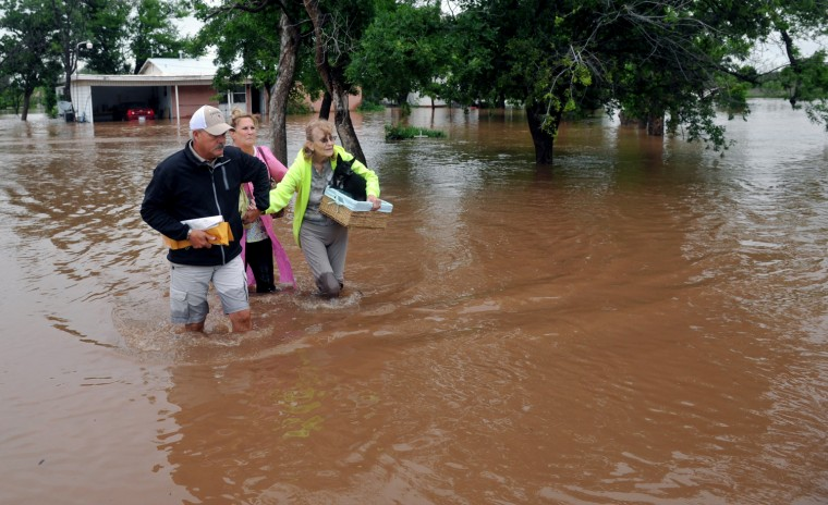 An elderly woman and her pets were rescued from her home on farm to market road 367, west of Wichita Falls, Texas, May 20, 2015. (Photo by Torin Halsey/Times Record News/AP)
