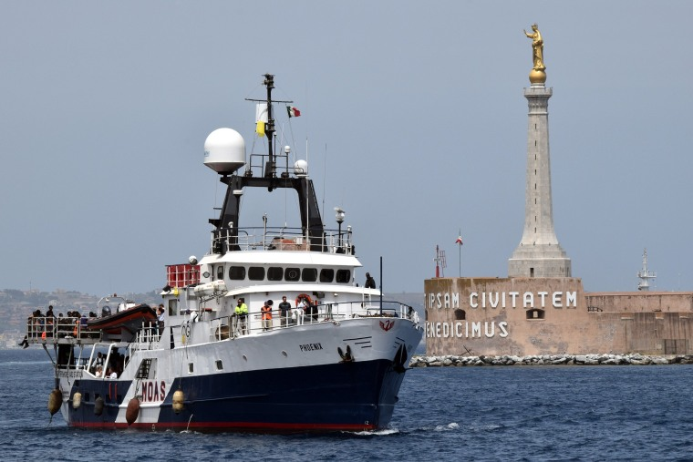 The Migrant Offshore Aid Station vessel arrives in the port of Messina, on May 16, 2015 following rescue operations of migrants at sea off the coast of Sicily in partnership with NGO Doctors Without Borders. (Photo by Giovanni Isolino/AFP/Getty)