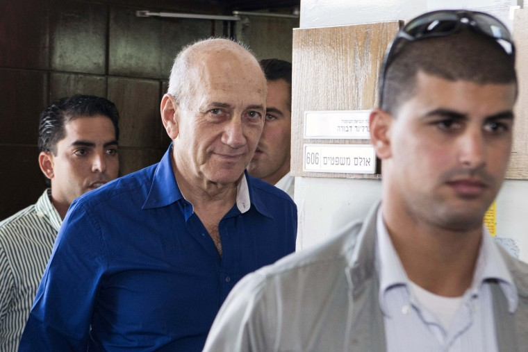 Former Israel prime minister Ehud Olmert (C) is sentenced to 6 years accusation of corruption in Tel Aviv, Israel on May 13, 2014. (Photo by Jack Guez/Anadolu Agency/Pool/Getty)