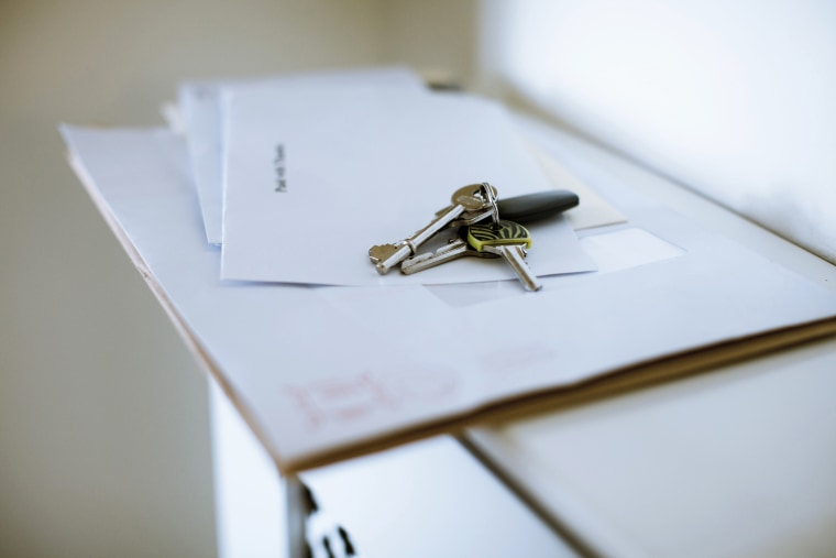 Keys on top of letters are seen in a home. (Photo by Trevor Hart/Gallery Stock)