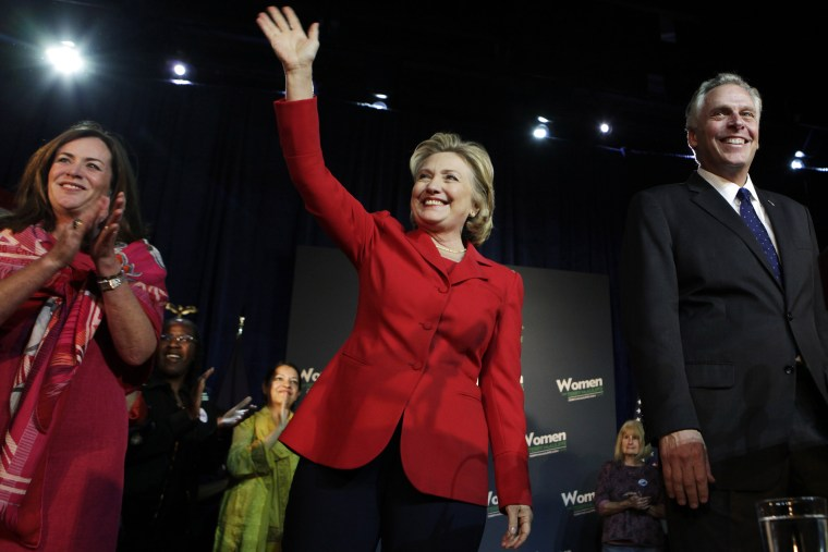 Former U.S. Secretary of State Hillary Clinton waves to the audience at an event in Falls Church, Va. on Oct. 19, 2013. (Photo by Yuri Gripas/Reuters)