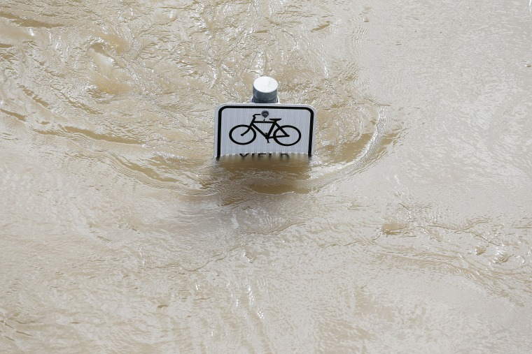 Water is seen at the top of a sign along a bike path near Memorial Drive in Houston, Texas on May 26, 2015. (Photo by Aaron M. Sprecher/AFP/Getty)