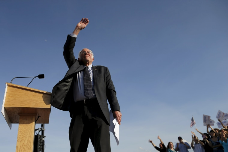 Democratic presidential candidate and U.S. Senator Bernie Sanders waves to the crowd of supporters after speaking at a campaign kickoff rally in Burlington, Vt., May 26, 2015. (Photo by Brain Snyder/Reuters)