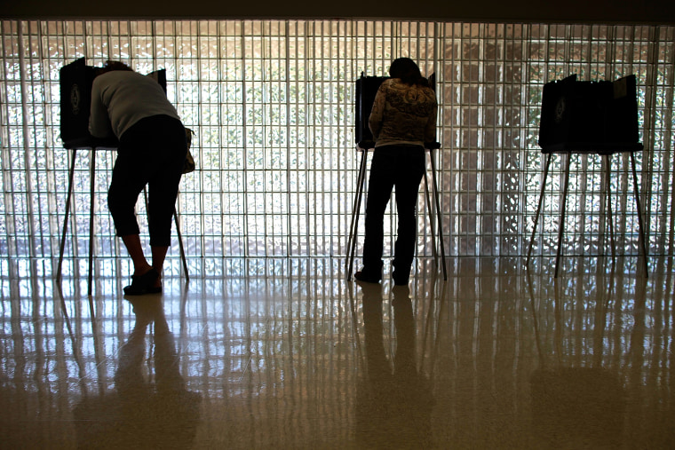 Voters cast their ballots on November 6, 2012 in Mansfield, Texas. (Photo by Tom Pennington/Getty)