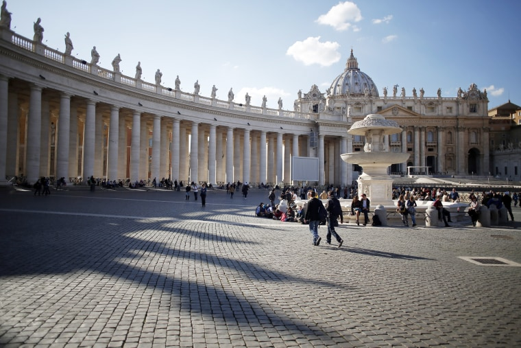 Visitors and tourists walk near the Basilica in St Peter's Square in Vatican City on Feb. 17, 2015. (Photo by Alessia Pierdomenico/Bloomberg/Getty)