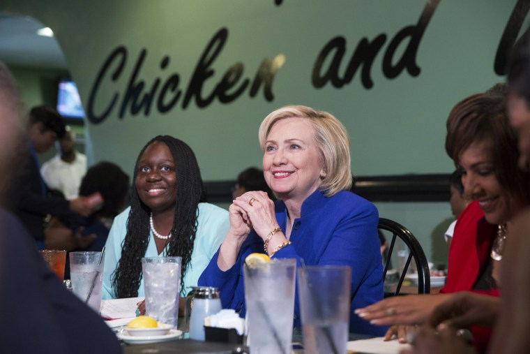 Hillary Clinton talks with people assembled to meet her while sitting with business leaders Kiki Smith Cyrus (L) and Cynthia Hardy (R) at Kiki's Chicken and Waffles restaurant in Columbia, S.C. on May 27, 2015. (Photo by Christopher Aluka Berry/Reuters)