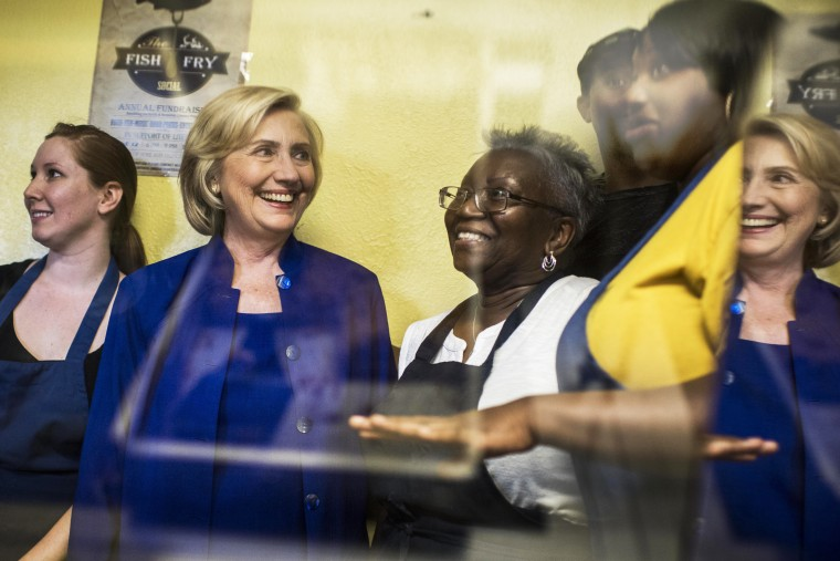 Former Secretary of State Hillary Clinton is shown the special treats at Main Street Bakery by owner Rosa Daniels, right, in Columbia, S.C. on May 27, 2015. (Photo by Melina Mara/The Washington Post/Getty)