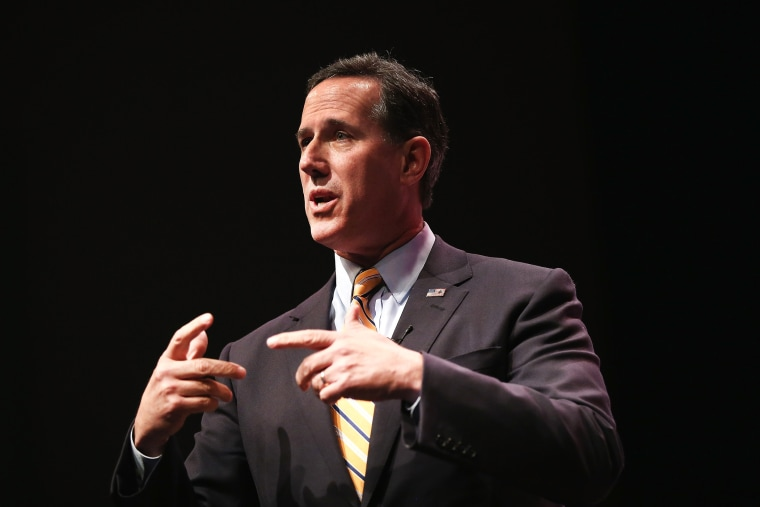 Former Pennsylvania Senator Rick Santorum speaks to guests gathered at the Point of Grace Church for the Iowa Faith and Freedom Coalition 2015 Spring Kickoff on April 25, 2015 in Waukee, Iowa. (Photo by Scott Olson/Getty)