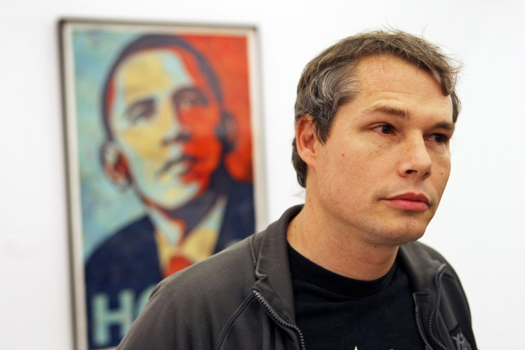 """At the Institute of Contemporary Art, an exhibit of Shepard Fairey's first solo museum show with the Obama """"Hope,"""" 2008, over the artist's shoulder. (Photo by David L. Ryan/Boston Globe/Getty)"""
