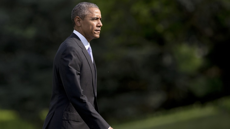 President Barack Obama walks across the South Lawn of the White House from Marine One, May 28, 2015, in Washington, D.C. (Photo by Carolyn Kaster/AP)