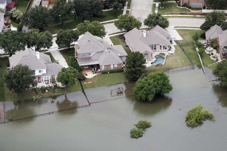 Lake Lewisville encroaches on residents backyards on May 29, 2015 in The Colony, Texas. (Photo by Brandon Wade/AP)