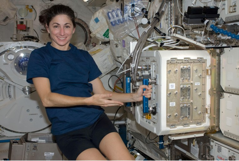 NASA astronaut Nicole Stott, Expedition 20/21 flight engineer, is pictured near the Mice Drawer System (MDS) in the Kibo laboratory of the International Space Station.