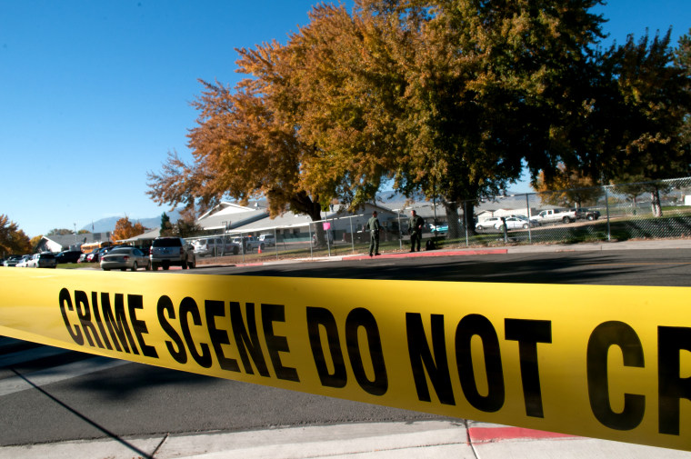 Police tape secures a crime scene on Oct. 21, 2013. (Photo by David Calvert/Getty)