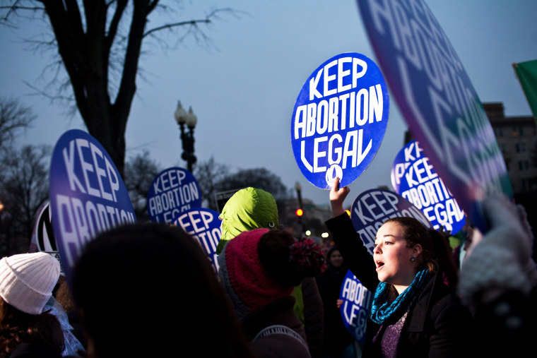 Pro-choice activists hold a vigil outside the U.S. Supreme Court on January 23, 2012 in Washington, DC. (Photo by Brendan Hoffman/Getty)