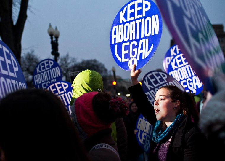 Pro-choice activists hold a vigil outside the U.S. Supreme Court on Jan. 23, 2012 in Washington, DC. (Photo by Brendan Hoffman/Getty)
