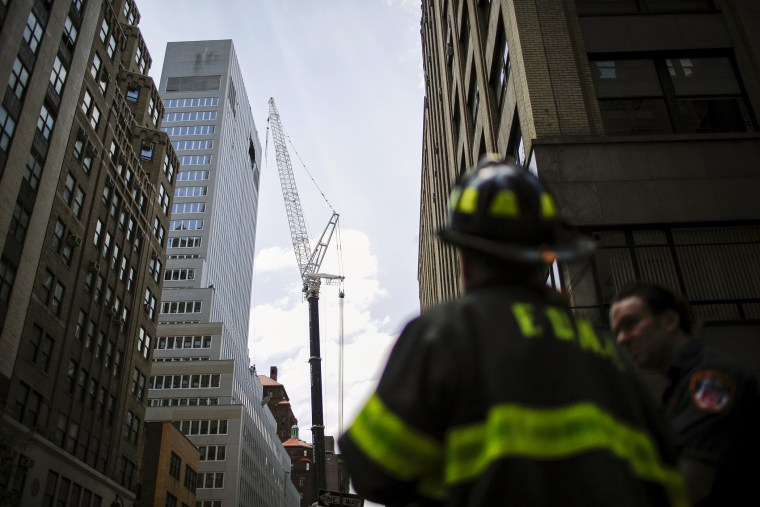 New York Fire Department members attend an emergency response after the cable of the crane snapped on a building in New York, N.Y., May 31, 2015. (Photo by Eduardo Munoz/Reuters)