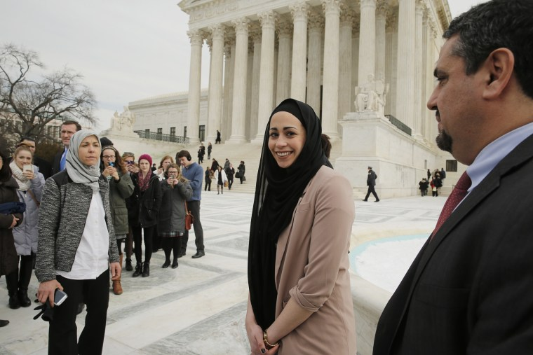 Muslim woman Samantha Elauf (C), who was denied a sales job at an Abercrombie Kids store in Tulsa in 2008, stands between her mother Majda (L) and EEOC General Counsel David Lopez (R) outside the U.S. Supreme Court in Washington, D.C., Feb. 25, 2015.