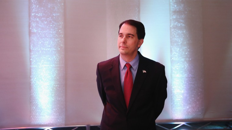 Governor Scott Walker of Wisconsin prepares to speak at the Iowa Faith and Freedom Coalition 2015 Spring Kickoff on April 25, 2015 in Waukee, Iowa. (Photo by Scott Olson/Getty)