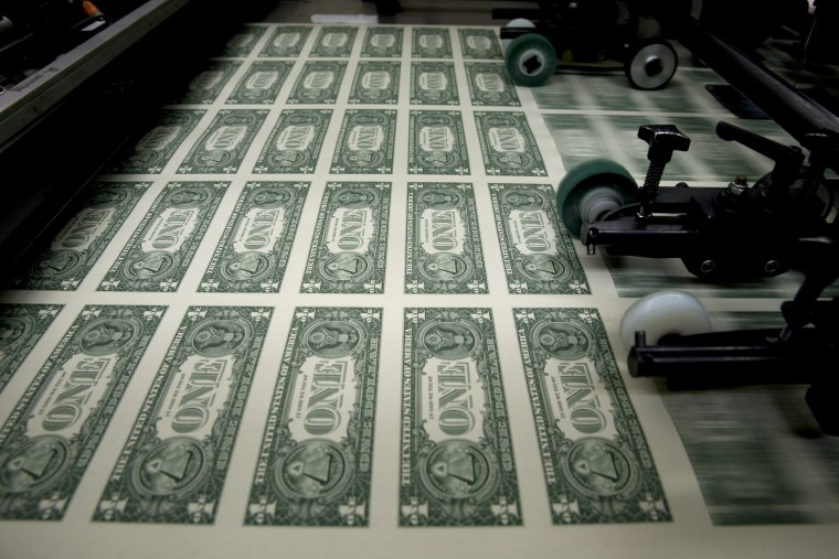 50 subject one dollar note sheets are run through an intaglio printing press before the face is printed at the U.S. Bureau of Engraving and Printing in Washington, D.C., April 14, 2015. (Photo by Andrew Harrer/Bloomberg/Getty)