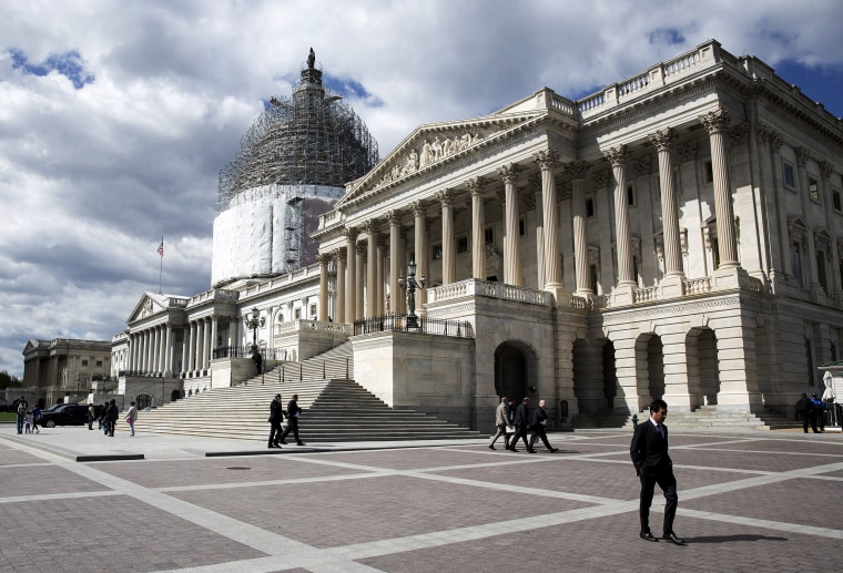A man walks in front of the U.S. Capitol in Washington April 23, 2015. (Photo by Joshua Roberts/Reuters)