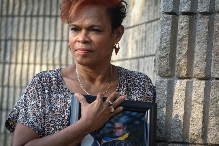 Jennifer Young, mother of Jermaine McBean, hold a photo of her son of when he received a computer-engineering degree, in Oakland Park, Fla., March 18, 2015. (Photo by Angel Valentin/The New York Times/Redux)