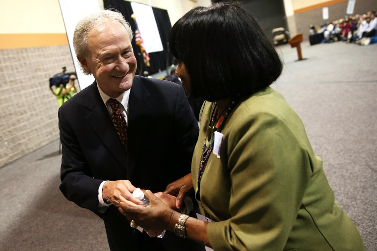 Potential Democratic presidential candidate former Sen. Lincoln Chafee (D-RI) greets a member of the audience after speaking at the South Carolina Democratic Party state convention April 25, 2015 in Columbia, S.C. (Photo by Win McNamee/Getty)