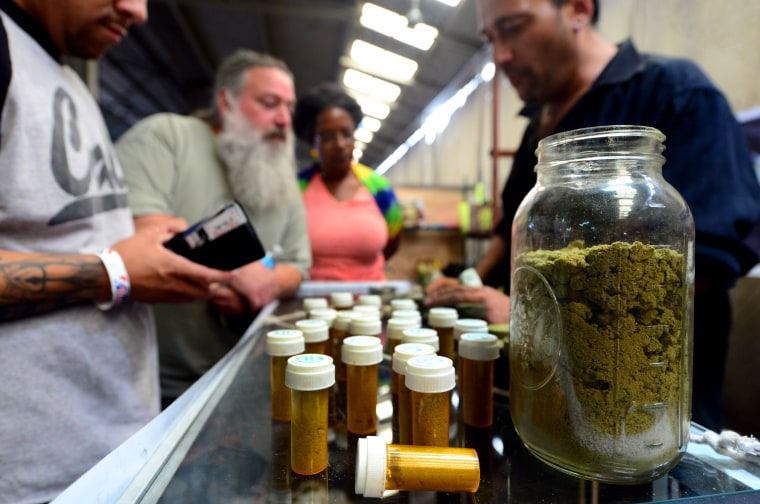 Card-carrying medical marijuana patients learn about Kief, in jar, at Los Angeles' first-ever cannabis farmer's market at the West Coast Collective medical marijuana dispensary, on Independence Day, July 4, 2014. (Photo by Frederic J. Brown/AFP/Getty)