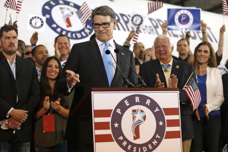 Former Texas Governor Rick Perry points to a supporter after announcing that he will run for president in 2016 June 4, 2015 in Dallas, Texas. (Photo by Ron Jenkins/Getty)