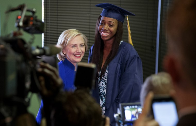 Democratic presidential candidate Hillary Clinton has her picture taken with Keenan High School graduate Dayzjohna Roberts at Kiki's Chicken and Waffles restaurant in Columbia, S.C., May 27, 2015. (Photo by Chris Aluka Berry/Reuters)
