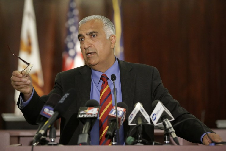 In this June 19, 2014, file photo, District Attorney Sim Gill speaks during a new conference, in Salt Lake City. (Photo by Rick Bowmer/AP)