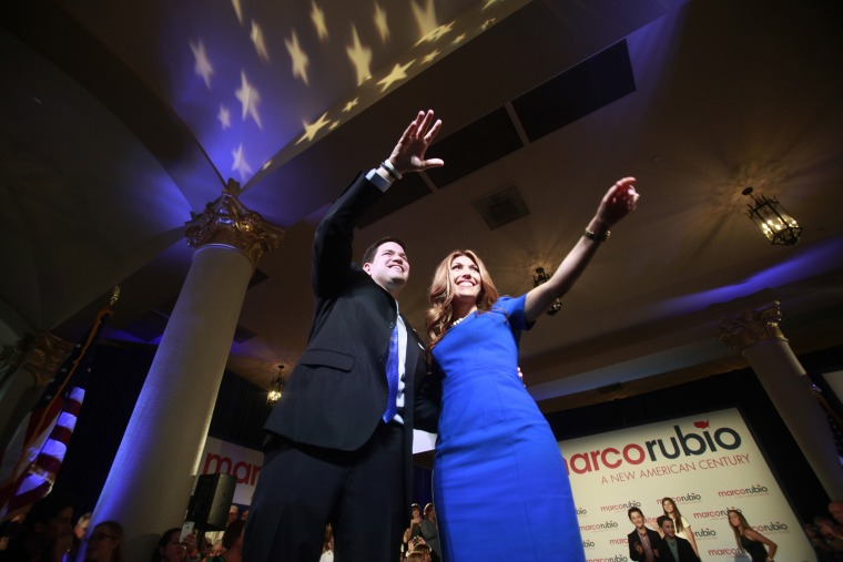 U.S. Senator Marco Rubio (R-FL) waves to the crowd with his wife Jeanette after he announced his bid for the Republican nomination in the 2016 U.S. presidential election race in Miami, Florida April 13, 2015. (Photo by Carlo Allegri/Reuters)