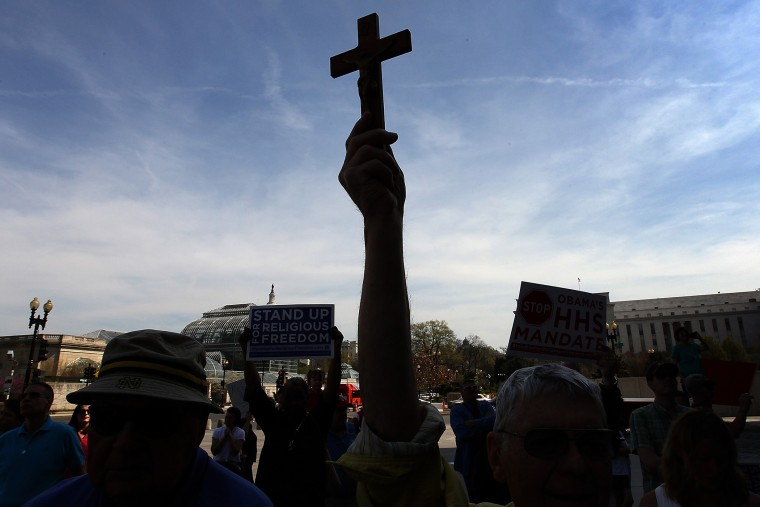 """Protesters participate in a \""""Stand Up for Religious Freedom\"""" rally on March 23, 2012 in Washington, DC. (Photo by Win McNamee/Getty)"""