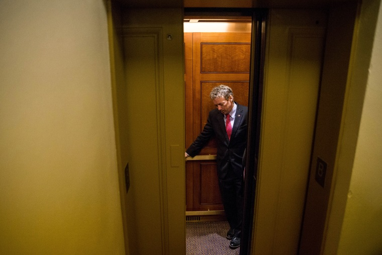 Republican presidential candidate, Sen. Rand Paul, R-Ky. departs in an elevator after speaking at a news conference on Capitol Hill in Washington, D.C., June 2, 2015. (Photo by Andrew Harnik/AP)