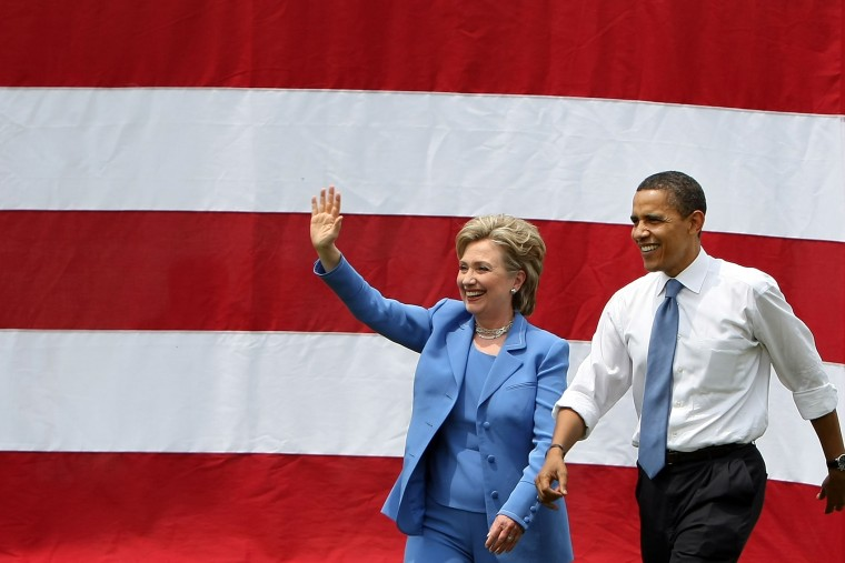 Democratic presidential candidate Sen. Barack Obama (D-IL) and Sen. Hillary Rodham Clinton (D-NY) wave to the crowd June 27, 2008 in Unity, N.H. (Photo by Mario Tama/Getty)